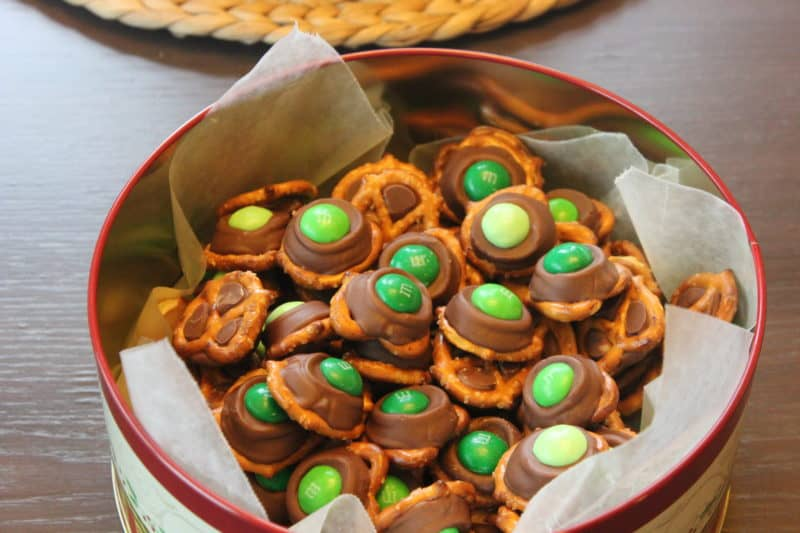 Rolo Pretzels with green mint M&Ms in tin.