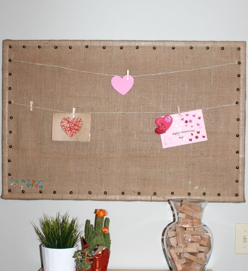 Bulletin board with twine and small sized clothes pins to hang cards, notes, etc.