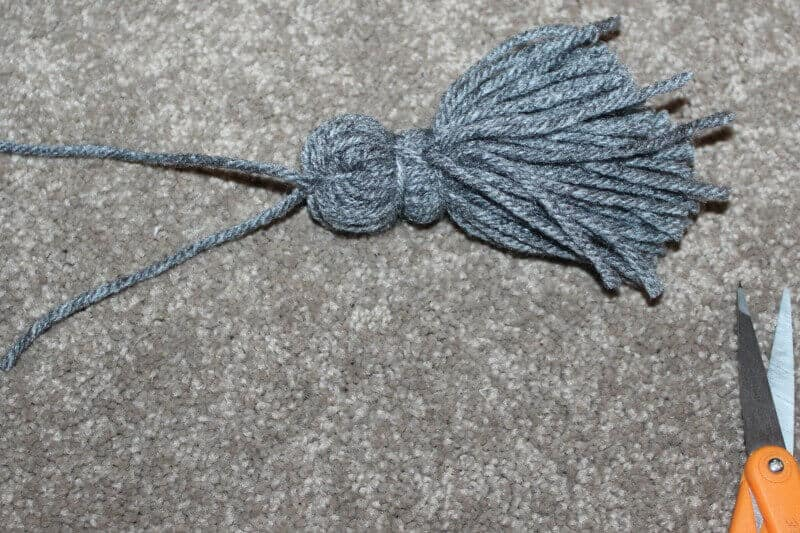Cut the loose ends of the tassel for a pom pom on the bookmark.