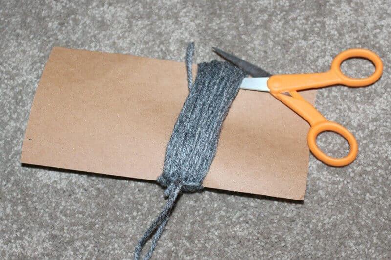 Cut the yarn to make pom pom for DIY bookmark
