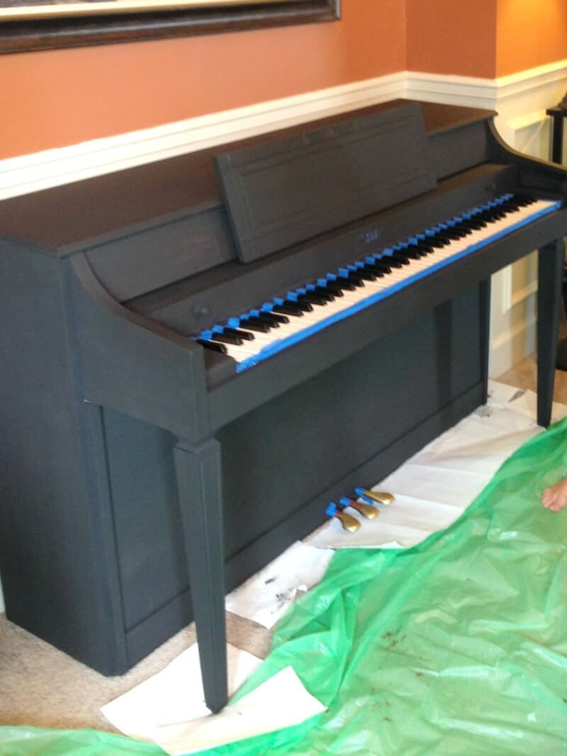 Piano makeover taping off the keys