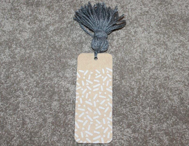 Tie the pompom tassel to the bookmark!