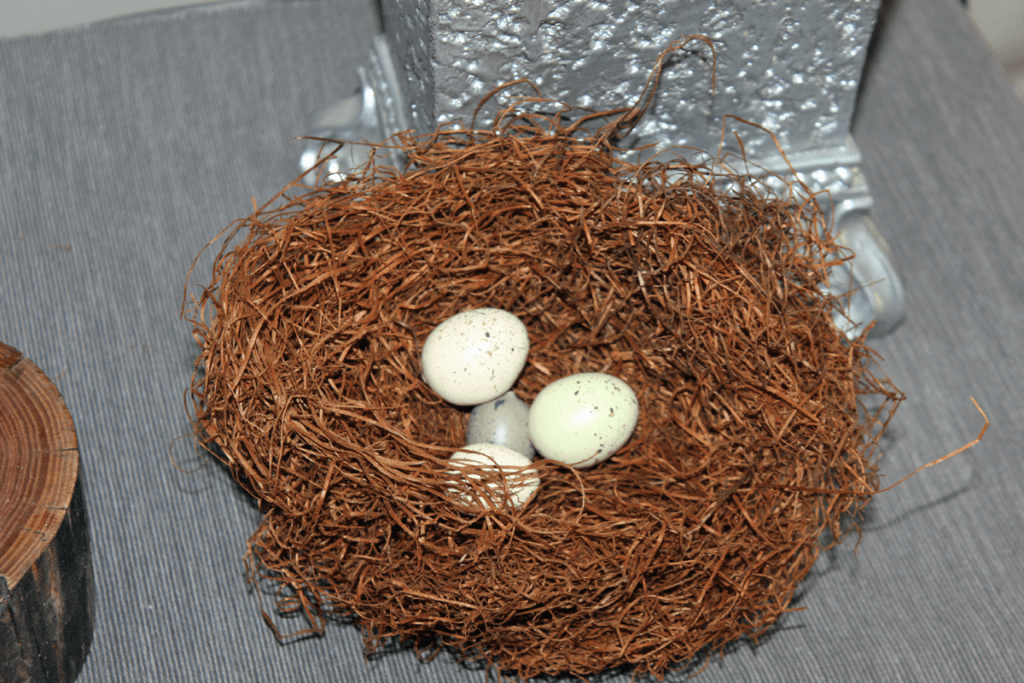 Add faux eggs to the DIY nests