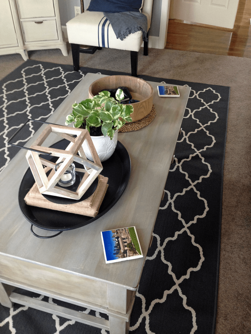 Before and after furniture makeover of coffee table; DIY coasters on table