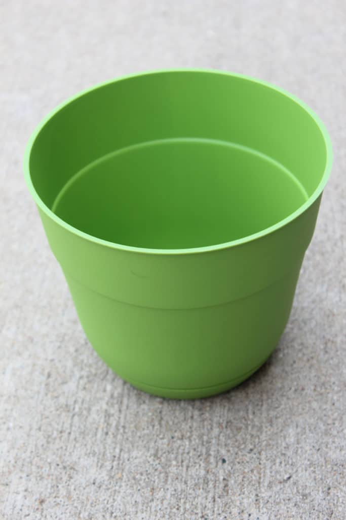 Plastic, green planter prior to updating with gray paint
