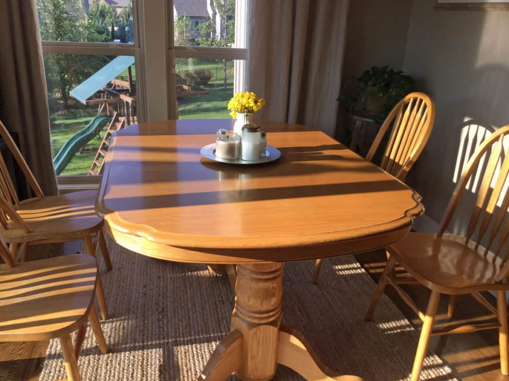 Orange oak table in breakfast nook