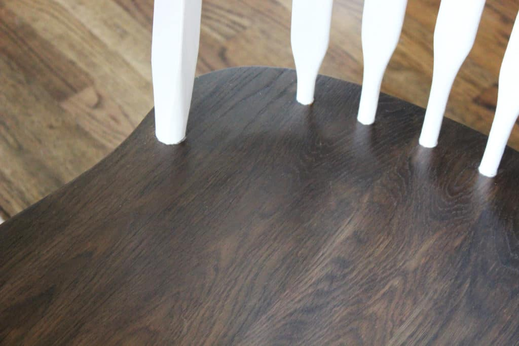 Kitchen table transformation; wood stain on the seat, white chalk paint on rest of chair