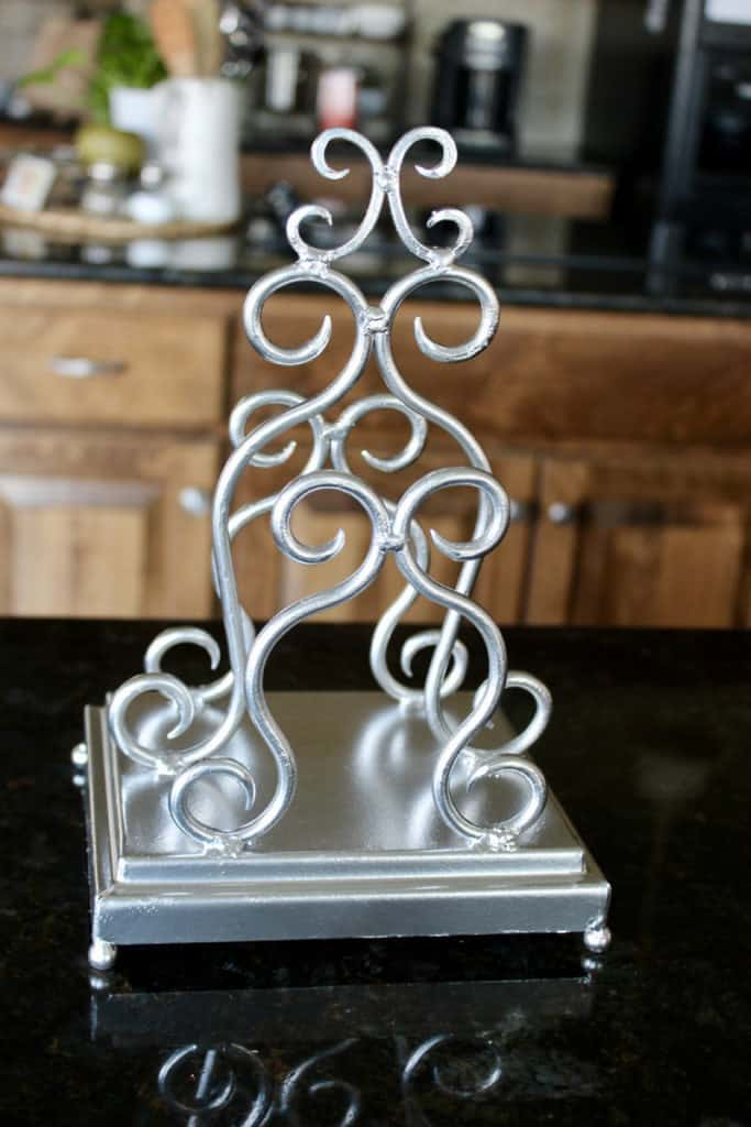 Napkin holder with metallic silver spray paint.