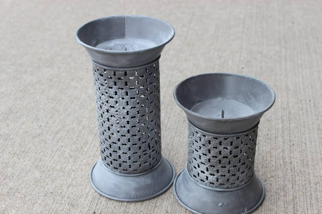 gray candlesticks after painting with dry brush technique