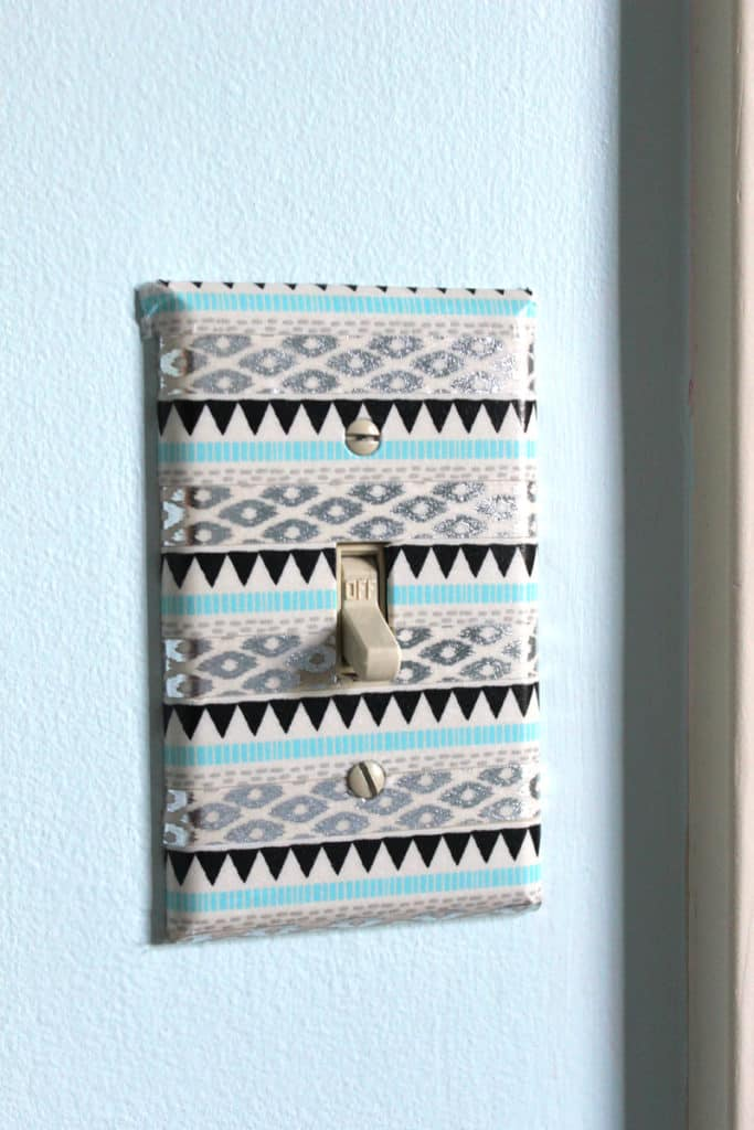 washi tape on light switch in tween bedroom