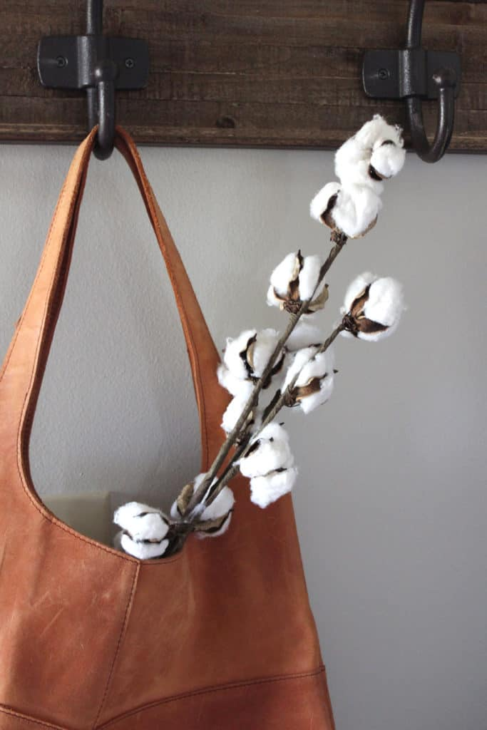 Raw cotton floral stems in a Magnolia bag from Joanna Gaines store.