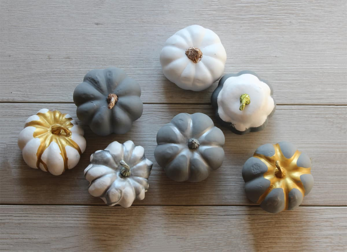 Painting mini pumpkins, metallic paint on plastic pumpkins