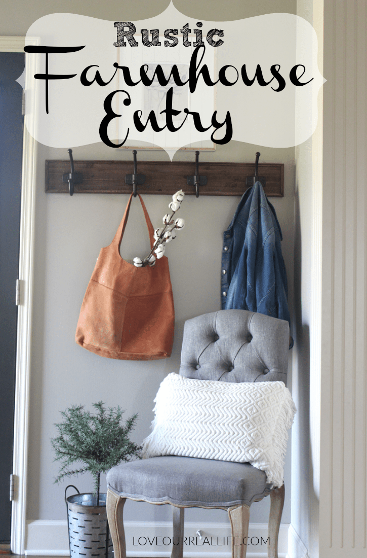 Farmhouse entryway including: , gray chair, wooden coat rack on the wall, leather purse from JoAnna Gaine's Magnolia shop