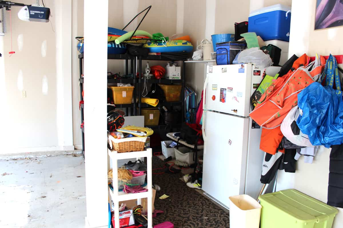 Mudroom and extra refrigerator in garage.