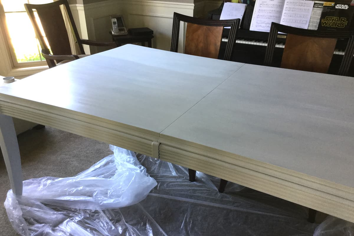 chalk paint on a dining table in white