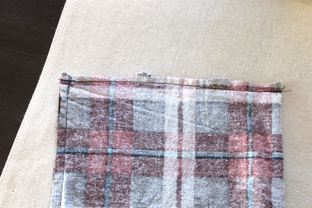 Sewing straight line seams on scarf.