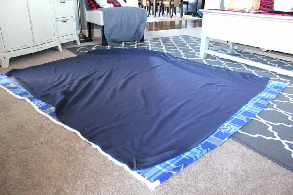 Match up your two patterns of fabric for no sew fleece blanket
