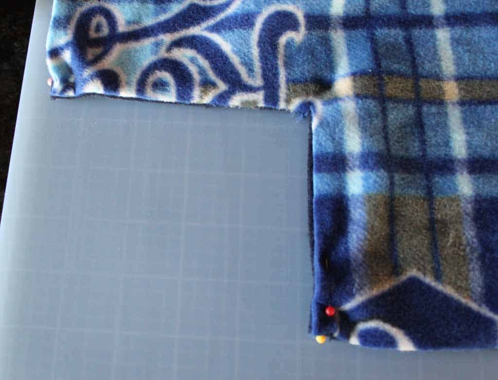 Cut 5 inch square from each corner of fleece no sew blanket