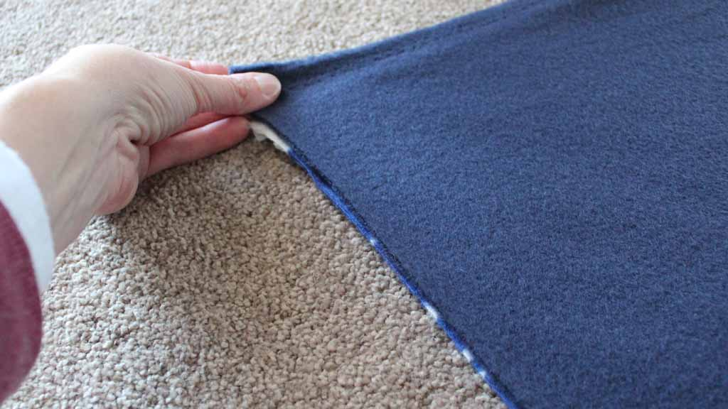 Lining up the two fabrics for DIY blanket
