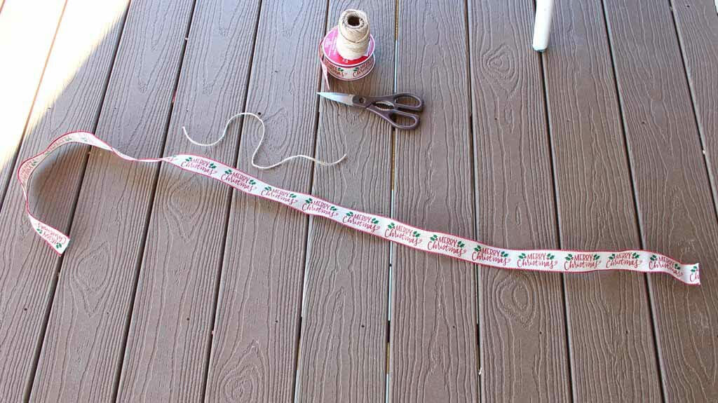 Items needed to make a gift bow: Wire ribbon, jute twine, scissors