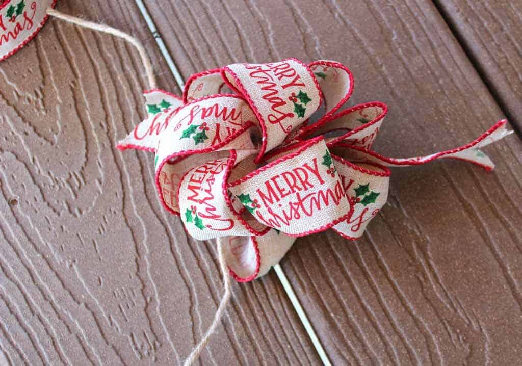 'Merry Christmas' wire ribbon bow for gifts.