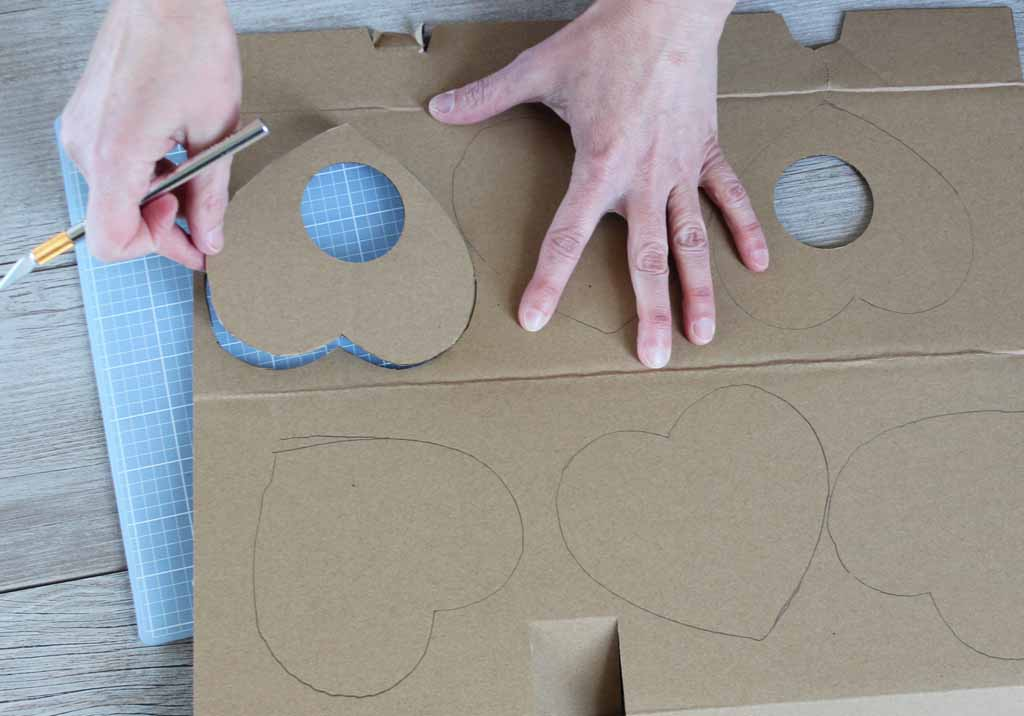 Cut out cardboard hearts for Valentine's banner