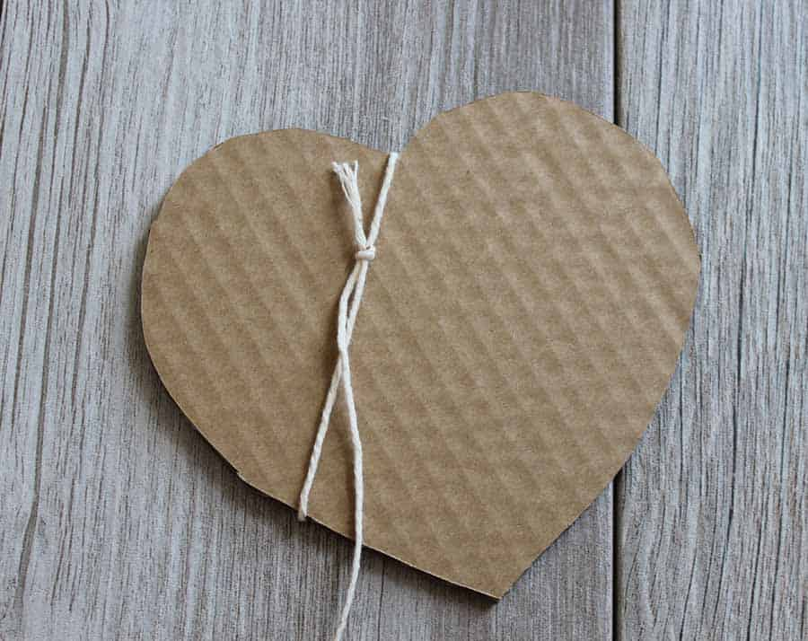 Wrap String around cardboard cut out to start the Valentine's Day banner