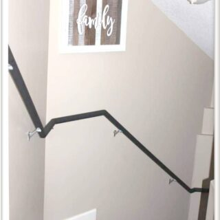 Black chalk paint to update stair railing