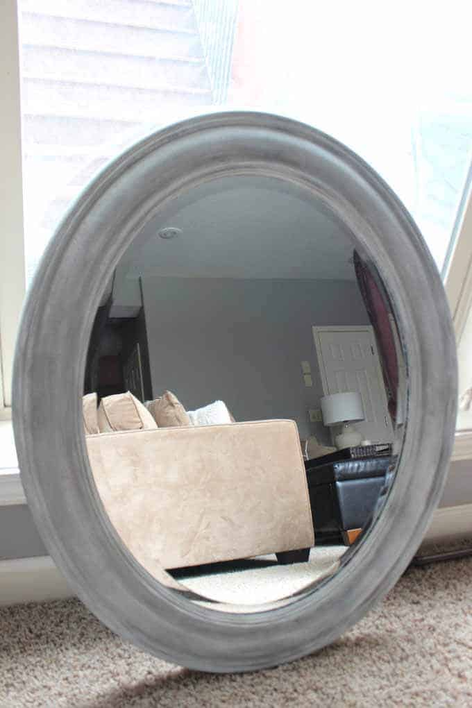 Update a mirror with chalk paint in layers of white and gray.