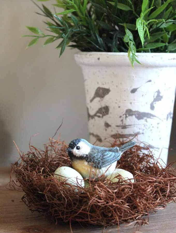 Faux birds nest and IKEA plant for spring home decor