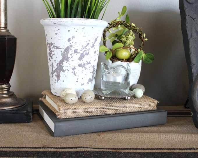 Decorating with books covered in burlap as well as old books painted with chalk paint.