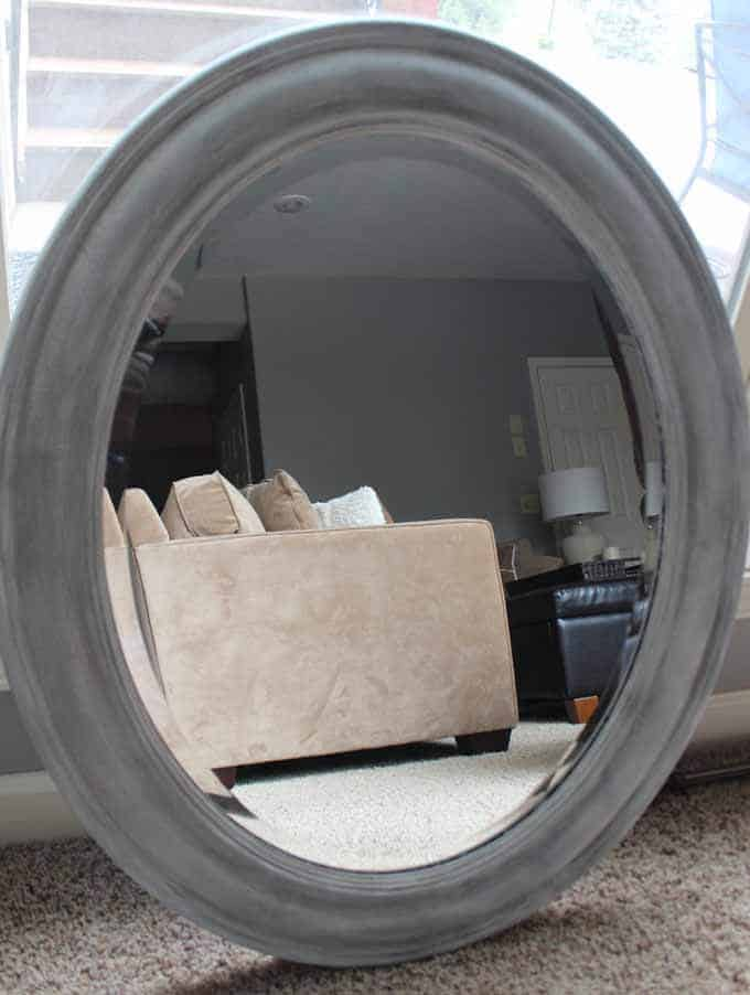 white and gray chalk paint to update an old gold / rust mirror.