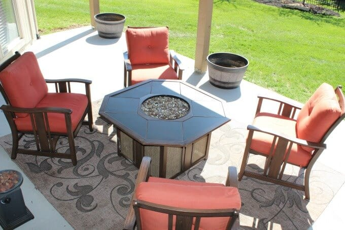 Concrete patio under deck with fire pit