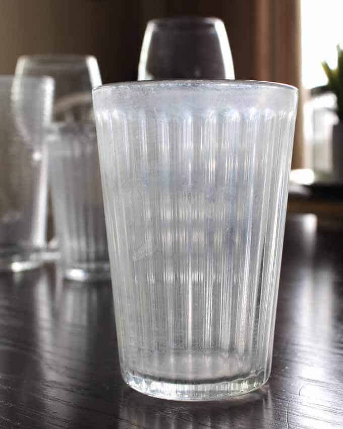 Water spots on glasses can be removed with magic erasers