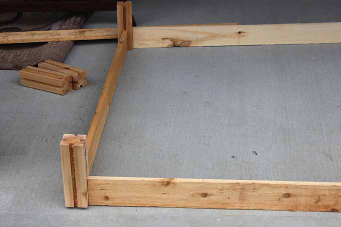 A pre-cut wood 4x4 raised bed garden kit.
