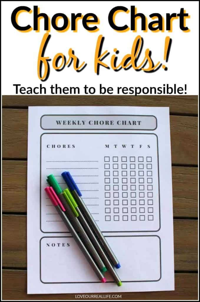 Printable chore chart with colored markers on wooden table.