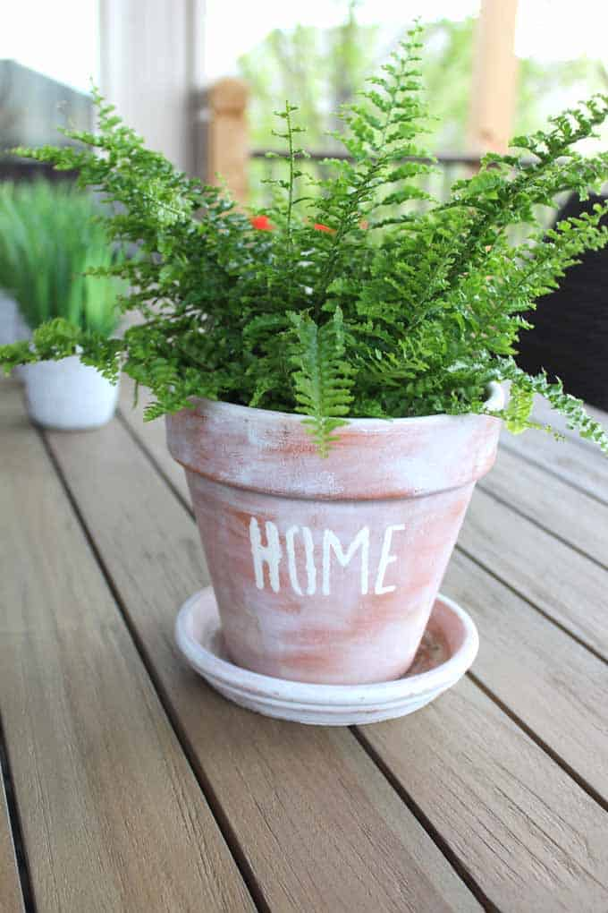 Stenciling your favorite words or sayings on terra cotta pots