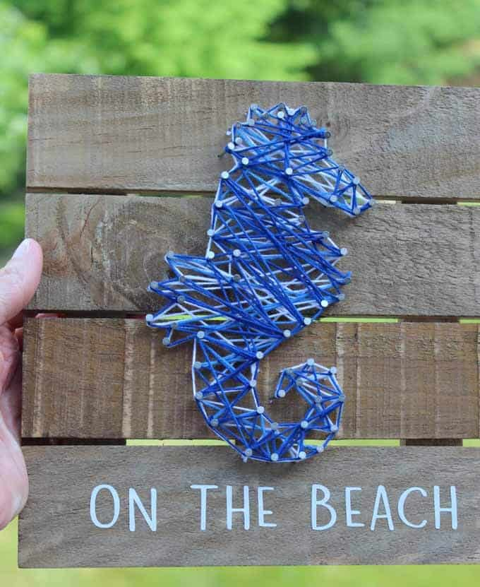 On the beach string art with seahorse.