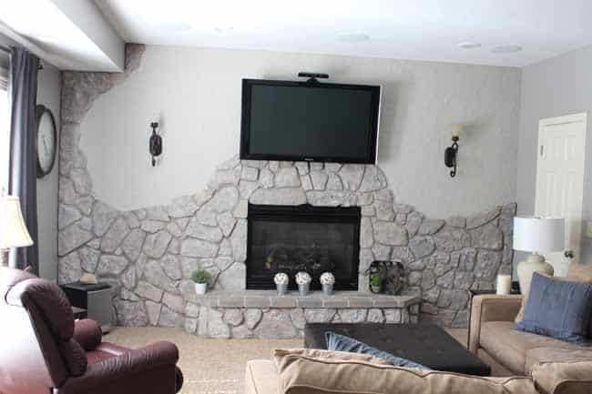 Update stone fireplace wall with gray paint.