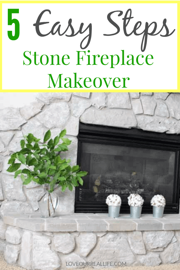 Updating brown stone fireplace with gray paint.