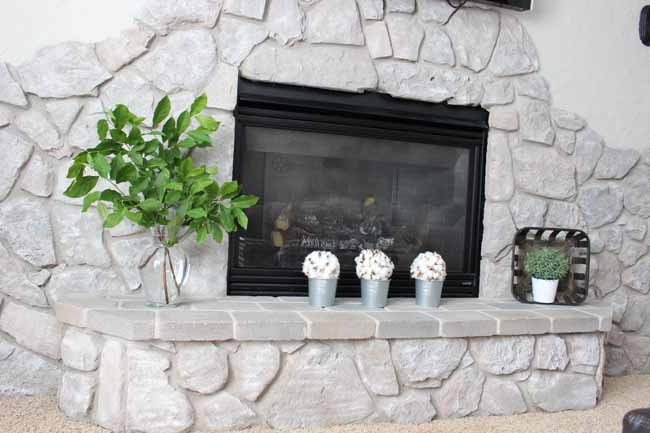 Painting a stone fireplace to make it look like new!
