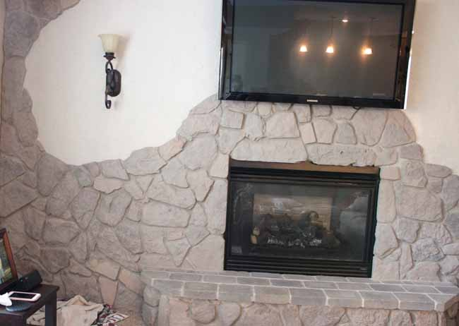 Gray chalk paint on fireplace stone wall.