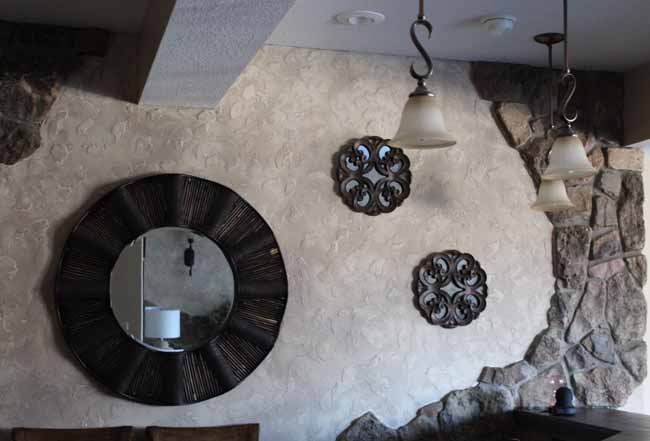 Painting outdated stone wall gray with white wash.