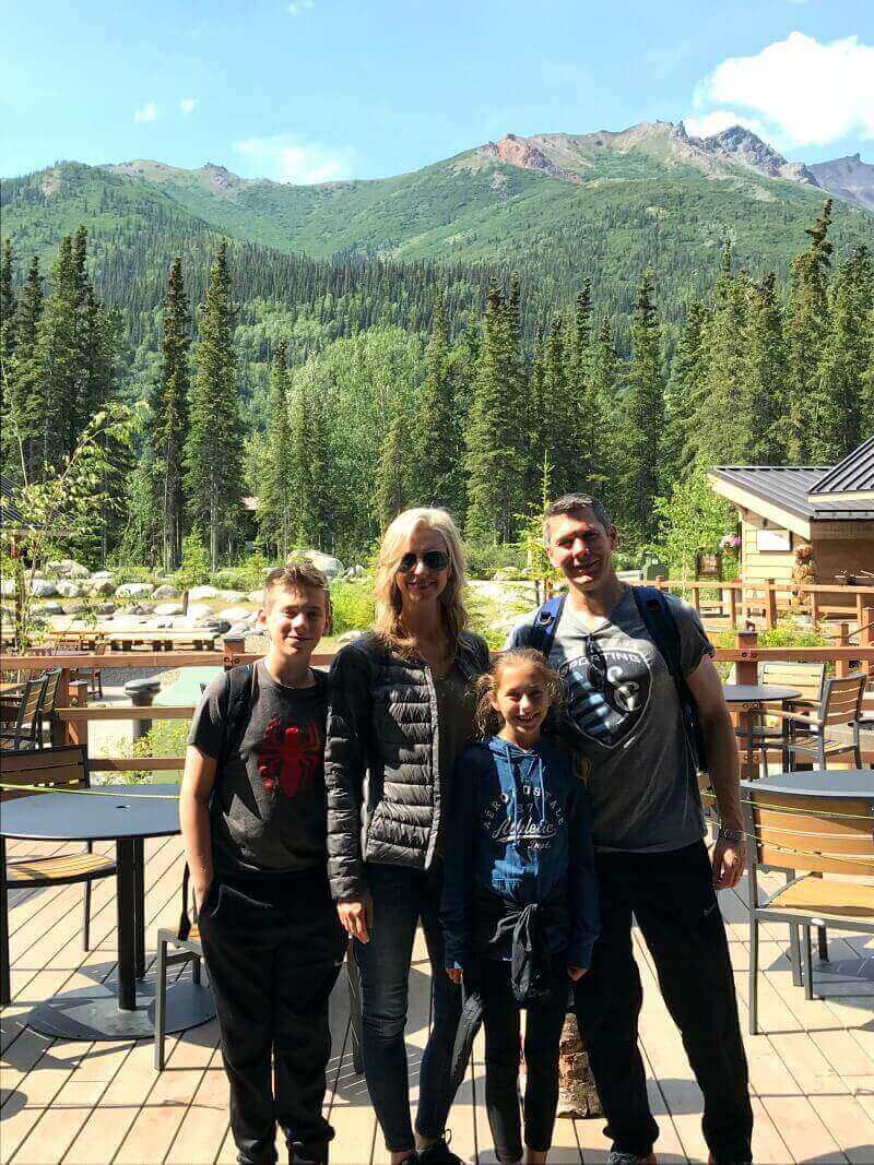 Photo of family of four at Denali in Alaska on sunny day.