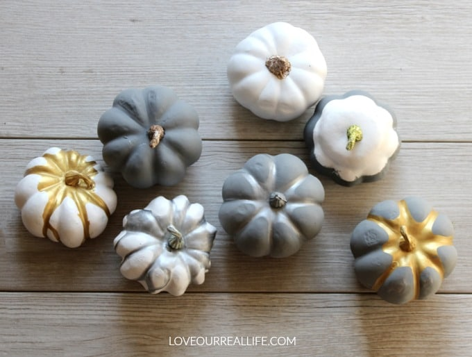 DIY painted pumpkins for a fall craft using chalk paint and acrylic paint