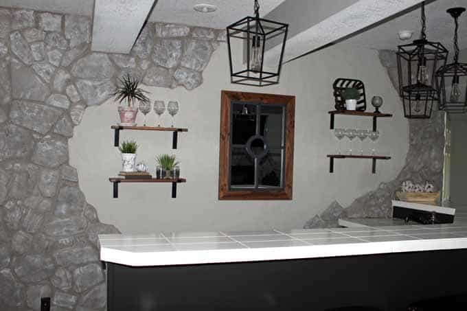 Heavy duty brackets were used to hand floating shelves behind the bar.