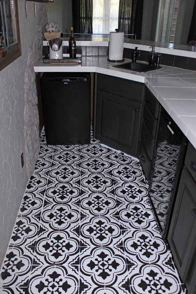 Stencil and paint were used to give this old tile an update on a dime. How to paint tile floors using stencils from Cutting Edge Stencils.