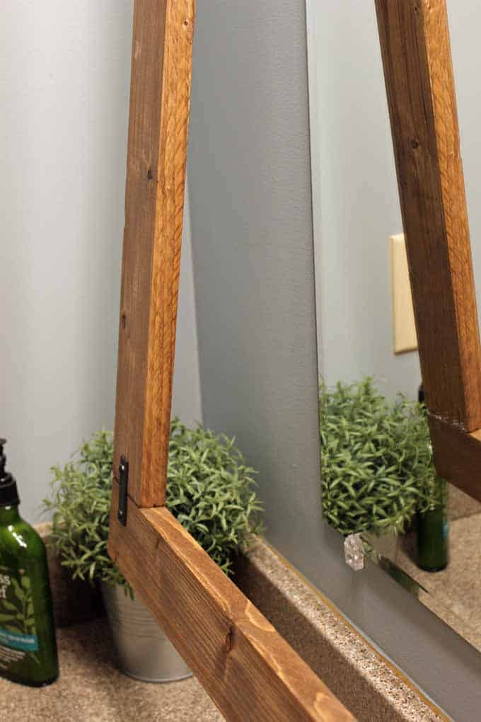 Instead of glueing the frame to the mirror, it was hung like a regular frame!