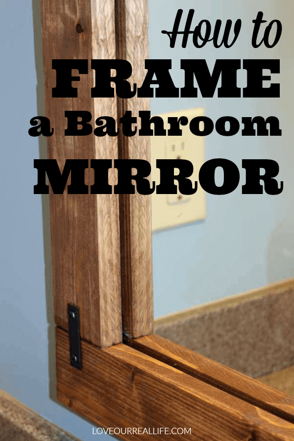 wood frame over bathroom mirror in Nimbus gray colored bathroom