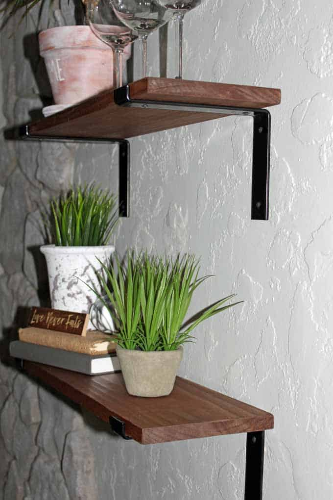 Rustic farmhouse shelves were stained in Minwax Special Walnut which worked great with the heavy duty black brackets.